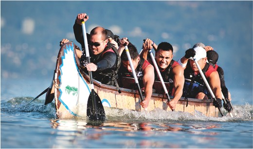 UBC students rowing longboat