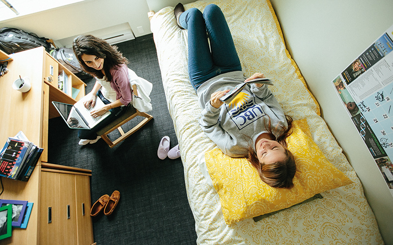 UBC students hanging out in a residence room on the Vancouver campus.
